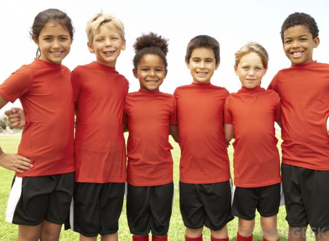 group-of-young-kids-in-red-shirts-and-black-shorts