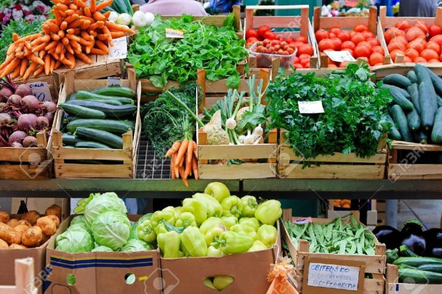 9243165-Fresh-and-organic-vegetables-at-farmers-market--Stock-Photo.jpg